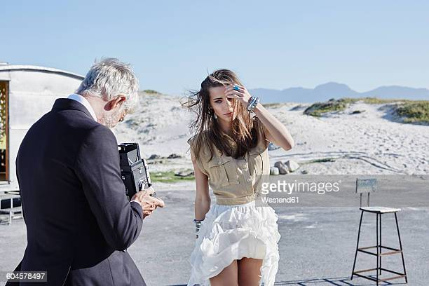 south africa, cape town, photographer taking pictures of a model - windy skirt stock photos and pictures