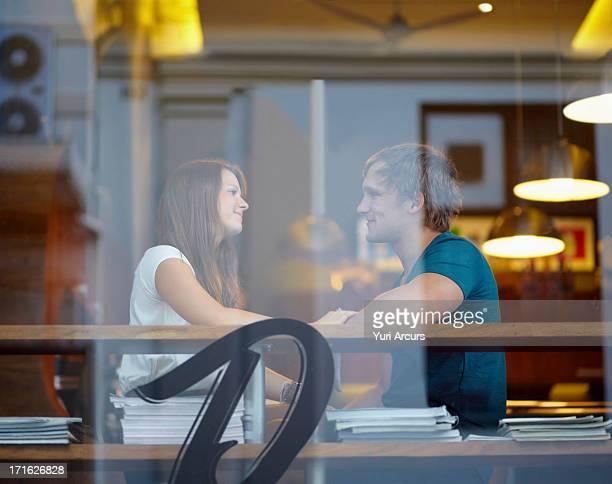 South Africa, Cape Town, Portrait of couple talking in coffee shop