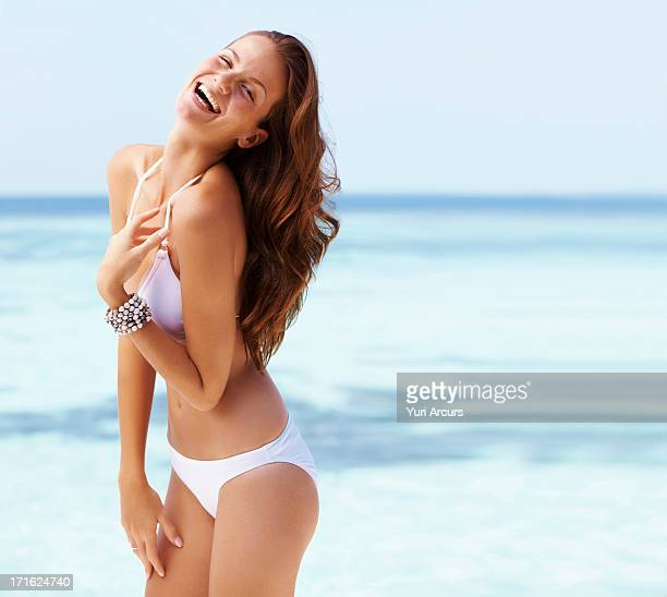 South Africa, Cape Town, Portrait of laughing young woman in bikini