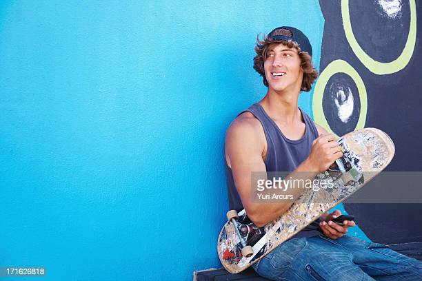 South Africa, Cape Town, Portrait of male skateboarder