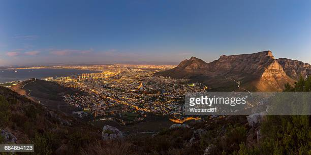 south africa, cape town with table mountain and signal hill at blue hour - table mountain stock pictures, royalty-free photos & images