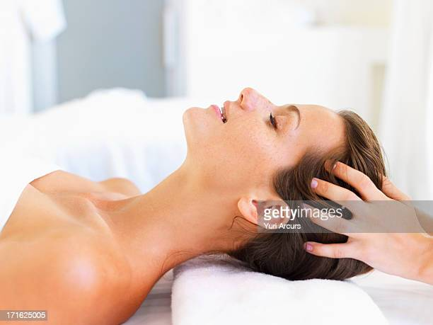 south africa, cape town, woman relaxing in spa - head massage stock photos and pictures