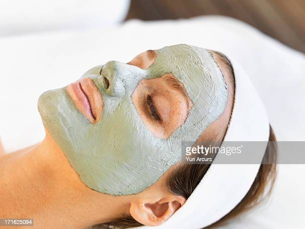 South Africa, Cape Town, Woman with face mask relaxing in spa