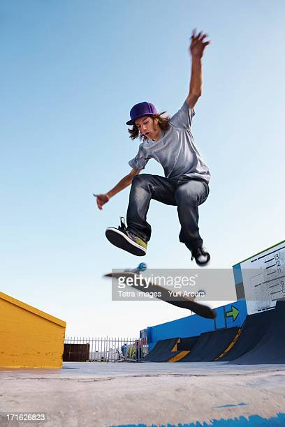 South Africa, Cape Town, Young man on skateboard jumping