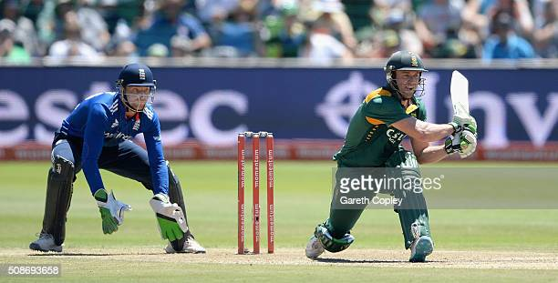 South Africa captain AB de Villiers bats watched by Jos Buttler of England during the 2nd Momentum ODI between South Africa and England at St...