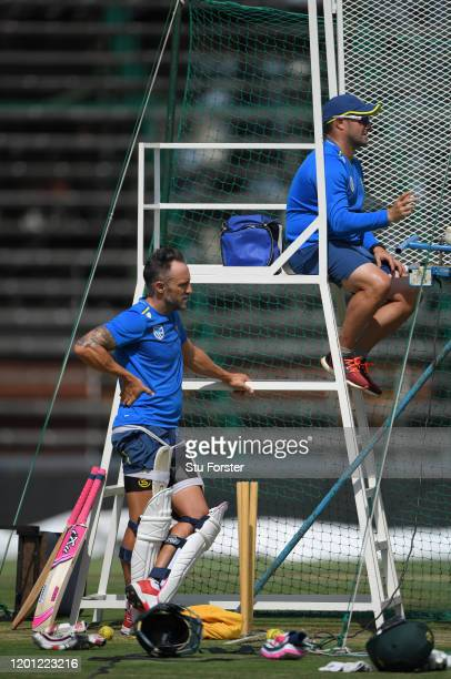 South Africa captain Faf du Plessis looks on as coach Mark Boucher feeds the bowling machine during South Africa nets at The Wanderers ahead of the...