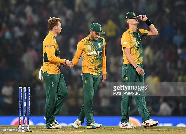 South Africa captain Faf du Plessisand teammates David Miller and Chris Morris walk back towards the pavilion after South Africa lost the World T20...