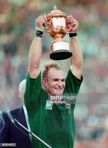 79eea3c2912 South Africa captain Francois Pienaar holds aloft the Webb Ellis trophy  after their 1995 World Cup
