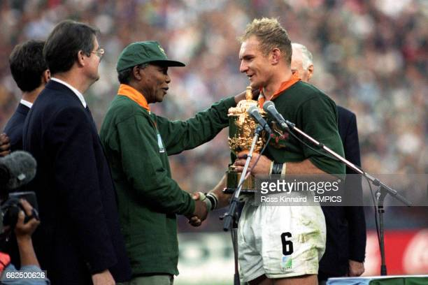 South Africa captain Francois Pienaar receives the William Webb Ellis Trophy from Nelson Mandela