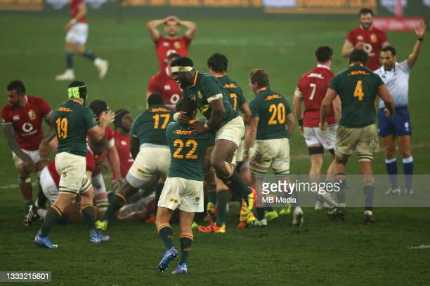 South Africa captain Siya Kolisi celebrates with Morne Steyn as Referee Mathieu Raynal for full time during the 3rd Test between South Africa and the...