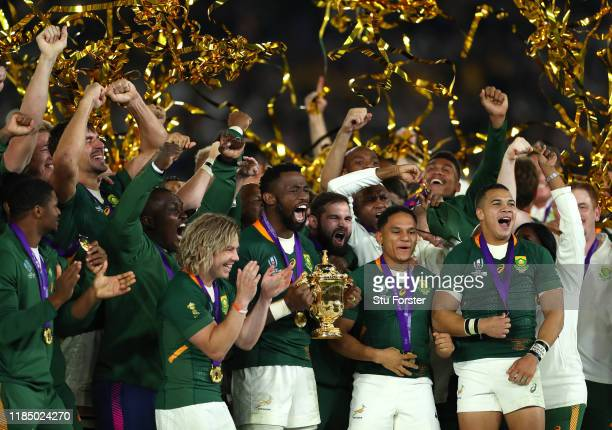 South Africa captain Siya Kolisi lifts the trophy with his team after the Rugby World Cup 2019 Final between England and South Africa at...