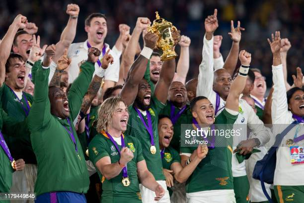 South Africa captain Siya Kolisi lifts the trophy with his team mates Faf de Klerk Herschel Jantjies and Cheslin Kolbe after the Rugby World Cup 2019...
