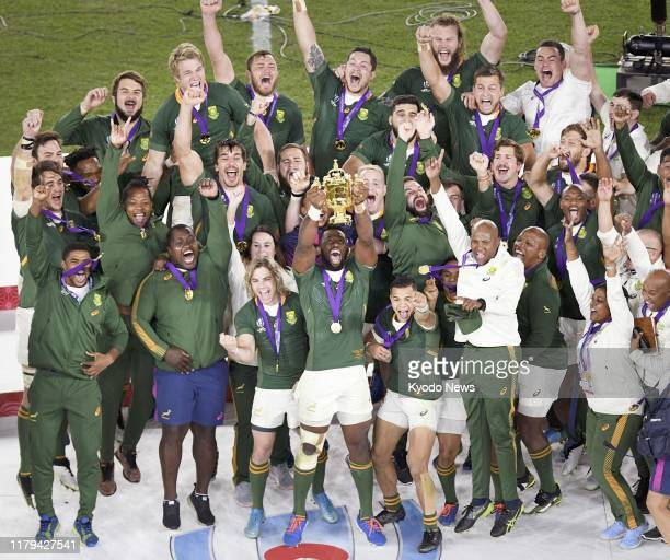 South Africa captain Siya Kolisi raises the Webb Ellis Cup as he celebrates with teammates after beating England 3212 to claim the country's third...
