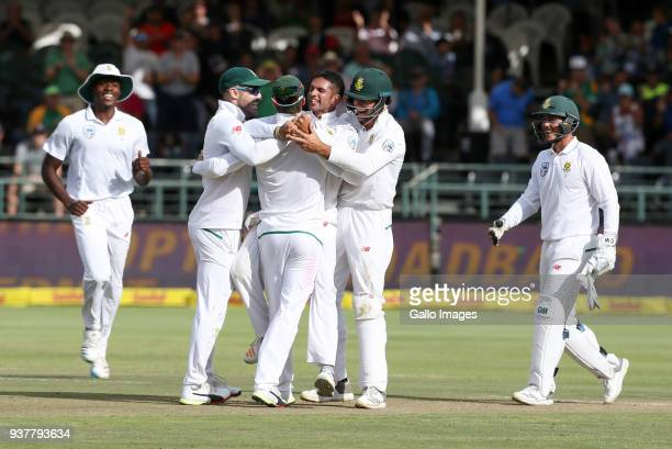 South Africa celebrate a wicket during day 4 of the 3rd Sunfoil Test match between South Africa and Australia at PPC Newlands on March 25 2018 in...