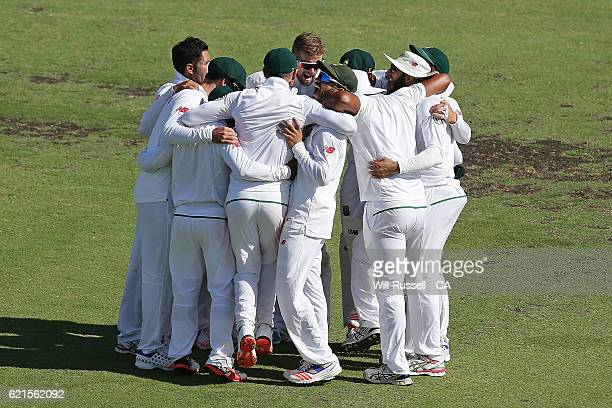 South Africa celebrate after dismissing Australia all out during day five of the First Test match between Australia and South Africa at WACA on...