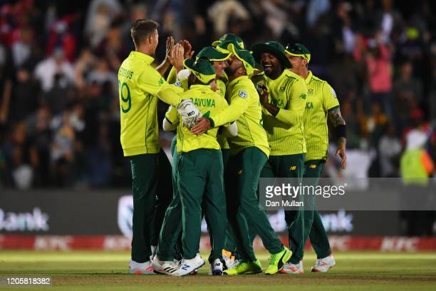 South Africa celebrate victory in the First T20 International match between South Africa and England at Buffalo Park on February 12, 2020 in East...
