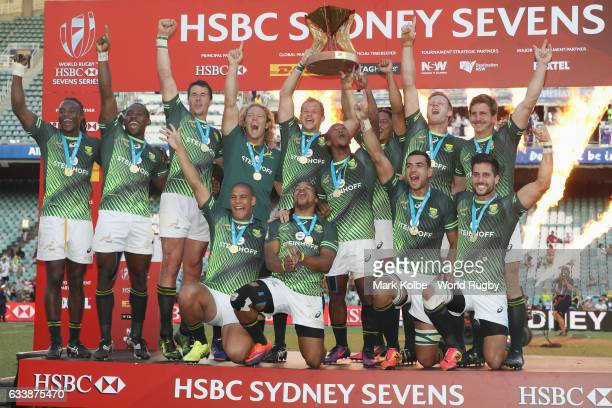 South Africa celebrate with the Cup after winning the Cup Final match between England and South Africa in the 2017 HSBC Sydney Sevens at Allianz...