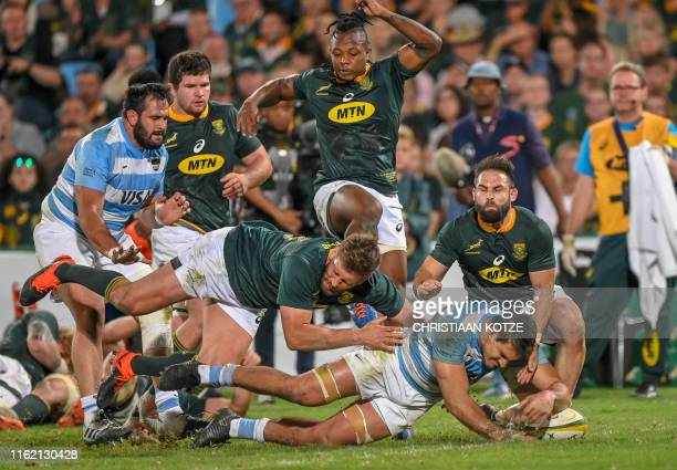 TOPSHOT South Africa centre Frans Steyn attempts to stop Argentina Captain and flanker Pablo Matera from scoring a try during their 2019 Rugby Union...