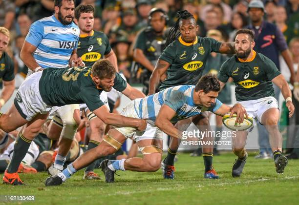 South Africa centre Frans Steyn attempts to stop Argentina Captain and flanker Pablo Matera from scoring a try during their 2019 Rugby Union World...