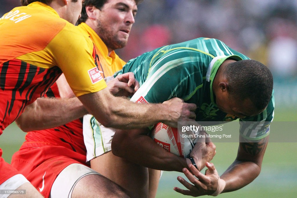 ***FOR NON-COMMERCIAL USE ONLY*** South Africa #5 Cornal Hendricks(R) tackled by England # 11 Mat Turner at the last day of the Cathay Pacific/ HSBC Hong Kong Rugby Sevens 2012 Sunday 25th, March 2012, at the Hong Kong Stadium, Causeway Bay. 25MAR12 : News Photo