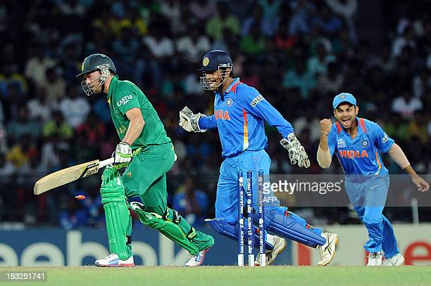 South Africa cricketer AB de Villiers is bowled out by Indian cricketer Yuvraj Singh as India wicketkeeper Mahendra Singh Dhoni and irat Kohli looks...