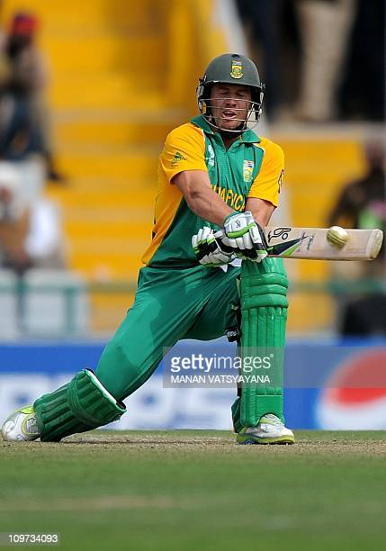 South Africa cricketer AB DeVilliers plays a reverse shot while on his way to scoring a century against the Netherlands during their World Cup match...