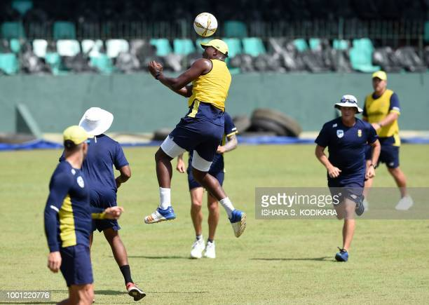 South Africa cricketer Lungi Ngidi plays football with teammates during a training session at the Sinhalese Sports Club cricket stadium in Colombo on...