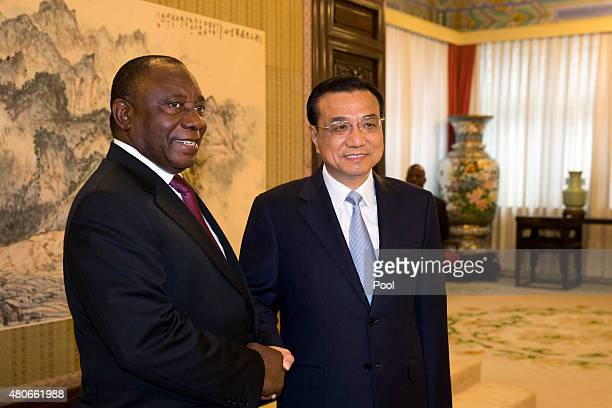 South Africa Deputy President Cyril Ramaphosa shakes hands with Chinese Premier Li Keqiang prior to a meeting at the Zhongnanhai leadership compound...