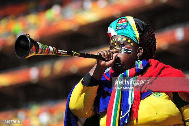 South Africa fan blows a Vuvuzela as she awaits the Opening Ceremony ahead of the 2010 FIFA World Cup South Africa Group A match between South Africa...