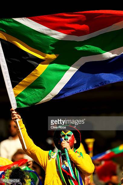 South Africa fan enjoys the atmosphere prior to the 2010 FIFA World Cup South Africa Group A match between France and South Africa at the Free State...