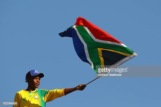 South Africa fan waves his national flag ahead of the 2010 FIFA World Cup South Africa Group A match between Mexico and Uruguay at the Royal Bafokeng...