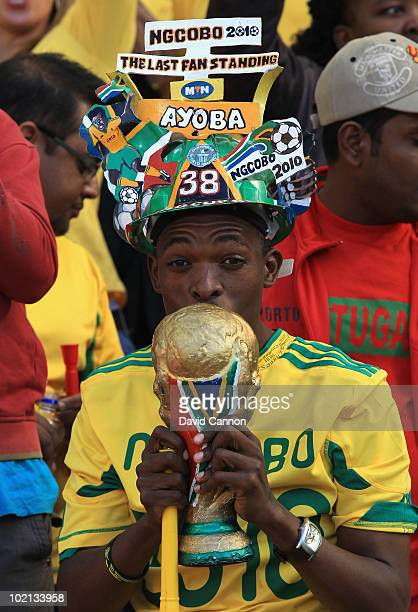 South Africa fan wears a Makarapa and kisses a replica World Cup ahead of the 2010 FIFA World Cup South Africa Group H match between Honduras and...