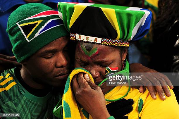 South Africa fan weeps as South Africa win their match but leave the competetion during the 2010 FIFA World Cup South Africa Group A match between...
