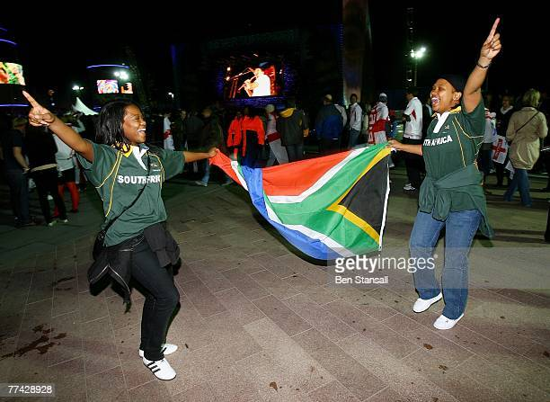 South Africa fans celebrate at the O2 Arena following their team's victory over England in the Rugby World Cup final on October 20 2007 in London...