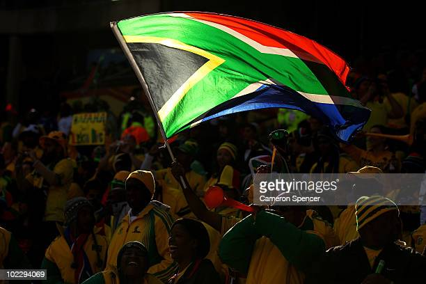 South Africa fans fly the national flag as they enjoy the atmosphere prior to the 2010 FIFA World Cup South Africa Group A match between France and...
