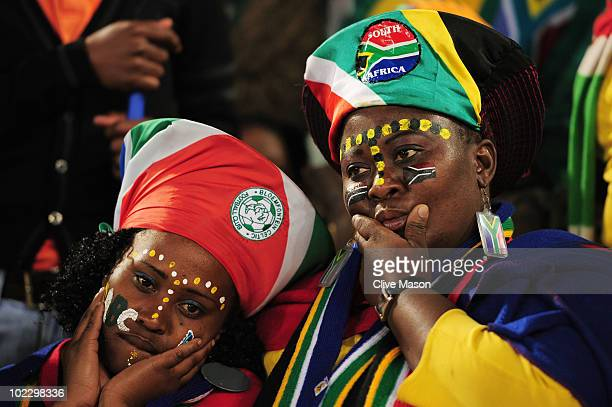 South Africa fans looks dejected as South Africa win their match but leave the competetion during the 2010 FIFA World Cup South Africa Group A match...