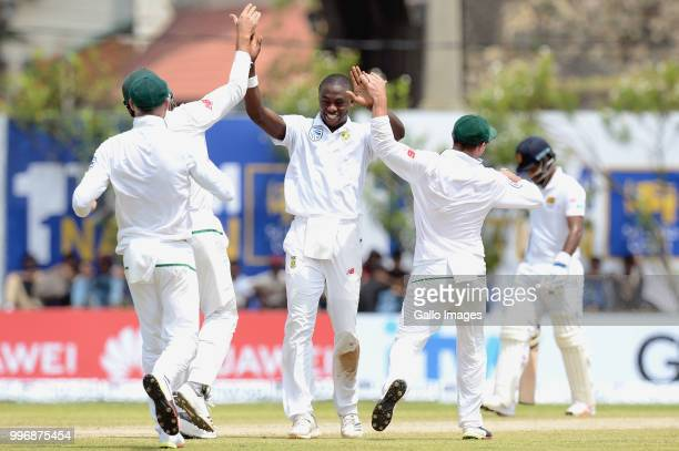 South Africa fast bowler Kagiso Rabada celebrating the wicket of Angelo Mathews with team mates during day 1 of the 1st Test match between Sri Lanka...