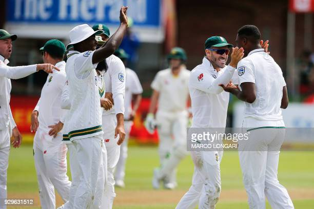South Africa fielder and Proteas captain Faf du Plessis celebrates South Africa bowler Lungi Ngidi taking the wicket of during day one of the second...