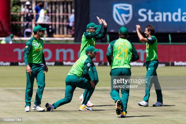 South Africa fielder David Miller is congratulated after the dismissal of Australia batsman Mitchell Marsh during the 3rd ODI between South Africa...
