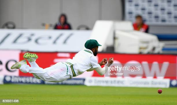 South Africa fielder Temba Bavuma dives in a vain attempt to catch England batsman Dawid Malan hits out during day three of the 4th Investec Test...