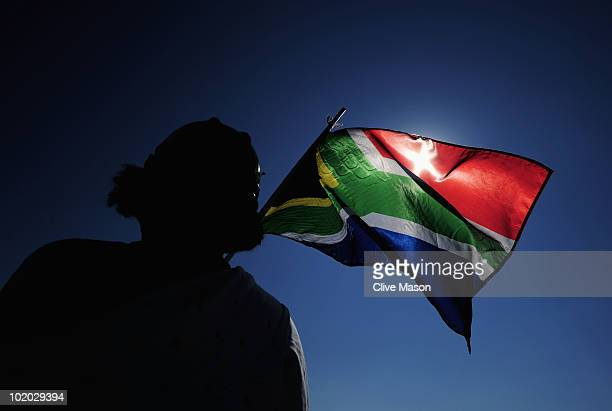 South Africa flag is waved ahead of the 2010 FIFA World Cup South Africa Group C match between Algeria and Slovenia at the Peter Mokaba Stadium on...