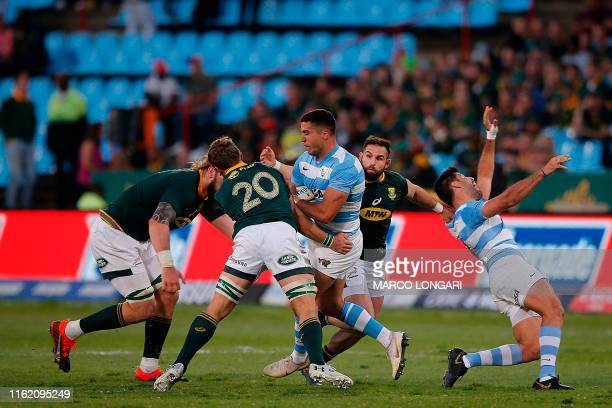South Africa flaker Marco van Staden and South Africa lock RG Snyman tackle Argentina centre Lucas Mensa as South Africa scrum half Cobus Reinach...