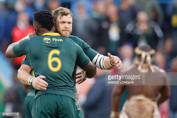 South Africa flanker and captain Siya Kolisi hugs South Africa's hooker Akker van der Merwe at the beginning of the second test match South Africa vs...