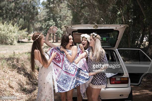 south africa, friends on a road trip changing chlothes - girl strips stock pictures, royalty-free photos & images