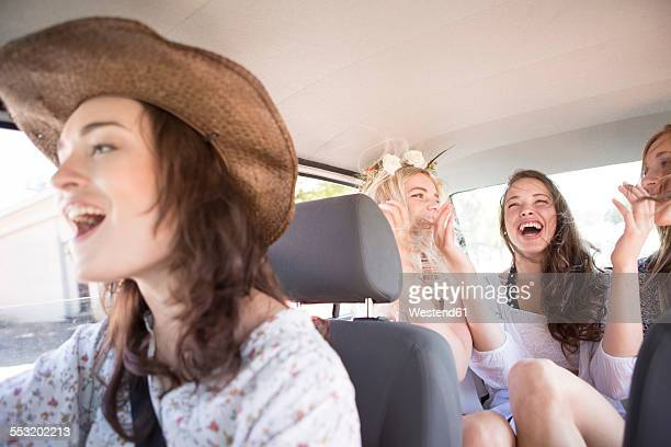 south africa, friends on a road trip driving in car - cantare foto e immagini stock