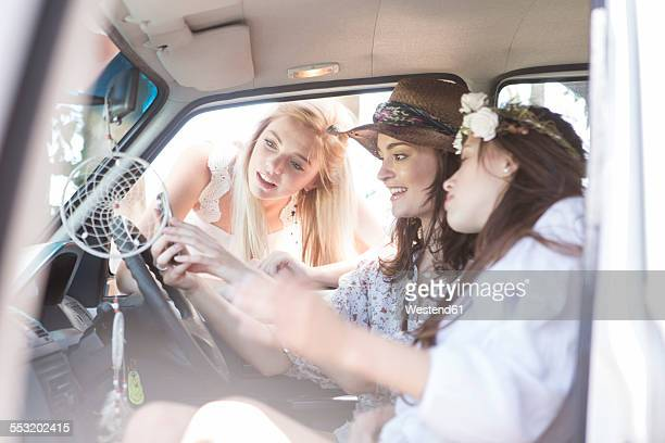 South Africa, Friends on a road trip looking at mobile phone
