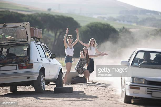 South Africa, Friends on a road trip stopping car for assistance with breakdown