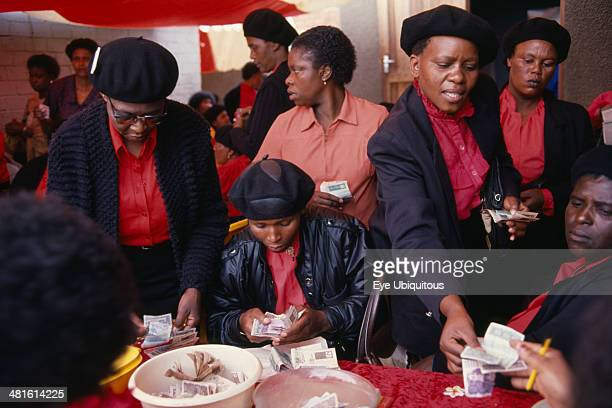 South Africa Gauteng Alexandra Township Female members of Burial Society or Stokvel counting money Funerals are seen as an important part of culture...