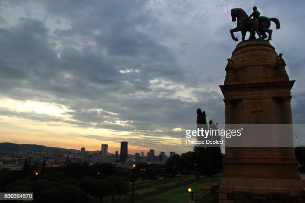 south africa, gauteng province, pretoria, the delville monument in front of union buildings at sunset - pretoria stock pictures, royalty-free photos & images