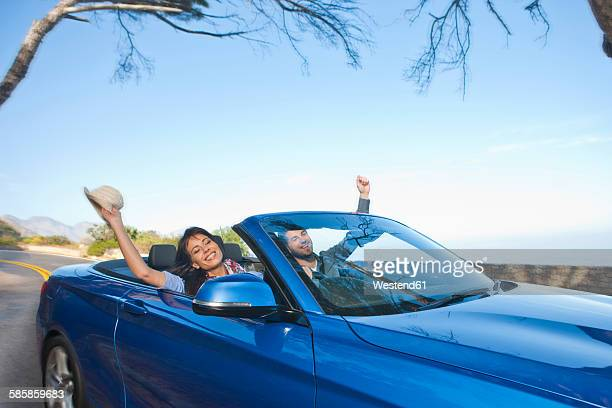 South Africa, happy couple in a convertible